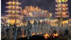 Malaysians of Chinese descent walk on burning charcoal during the Chinese Nine Emperor Gods Festival - a Taoist celebration - in Kuala Lumpur.