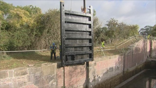 Lock gate being lowered into place