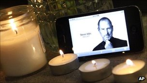 An iPhone displays an image of Steve Jobs at a makeshift memorial outside an Apple Store in New York on 5 October 2011