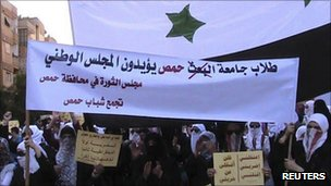 Demonstrators protesting against Syria's President Bashar al-Assad march through the streets in Homs on 4 October