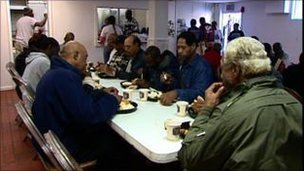 People eating at a food bank