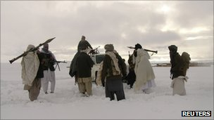 In this file picture released exclusively to Reuters, Taliban militants are seen with their weapons in an undisclosed location in Afghanistan on 16 January 2009.