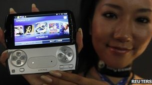 A model shows Sony Ericsson&#039;s Xperia PLAY phone