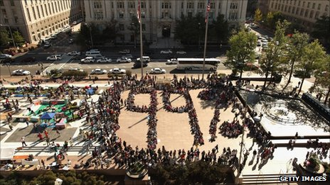 Protesters organise themselves into a 99% symbol in Freedom Plaza in Washington DC, 6 October 2011