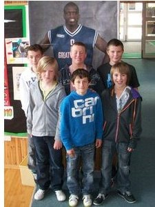 A bit bigger than expected...  Baltasound pupils stand in front of a life-size poster of Luol Deng