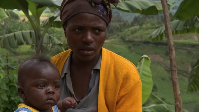 A child and woman in Butaro