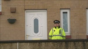 Police outside house in Heys Close, Blackburn after a man was found fatally stabbed