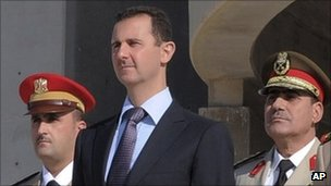 Syrian President Bashar al-Assad flanked by Syrian Defence Minister Gen Dawoud Rajha, right, and Chief of Staff Gen Fahed al-Jasem el-Freij, left - 6 October 2011