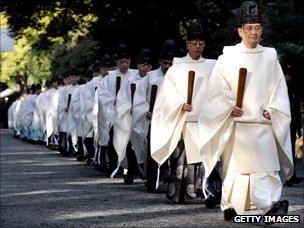 Shinto priests walk in line