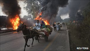 "Burning fuel tankers in Pakistan""s Khyber-Pakhtunkhwa Province in October 2010"
