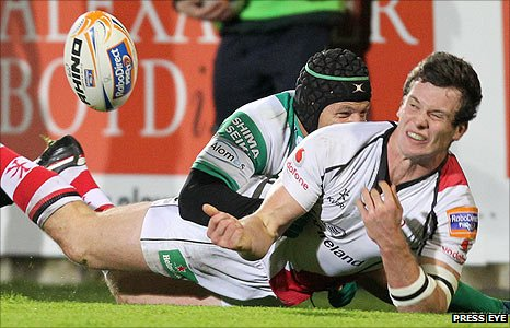 Kristopher Burton of Treviso tackles Ulster's Ian Whitten at Ravenhill