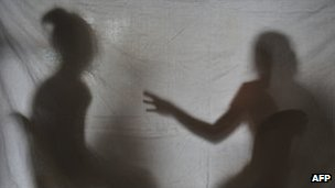 The silhouettes of two teenage girls rescued from a cyber sex den in Olongapo City, the Philippines, December 2010