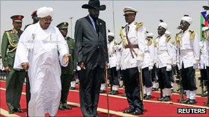 Sudan President Omar al-Bashir, left, welcomes South Sudan President Salva Kiir, at Khartoum airport on 8 October 2011