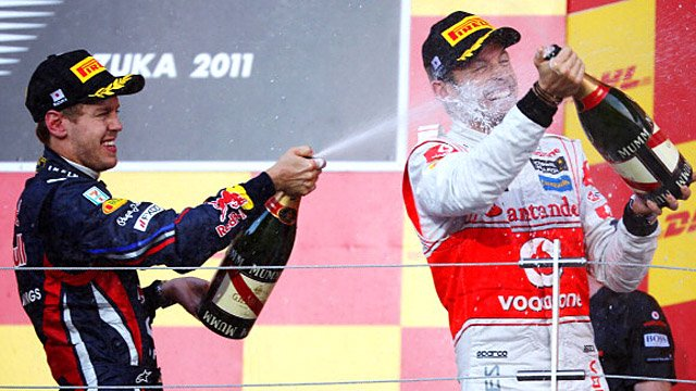 Red Bull's Sebastian Vettel and McLaren's Jenson Button celebrate