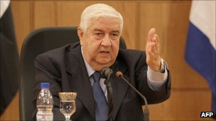 Syrian Foreign Minister Walid al-Moualem at a news conference in Damascus on 9 October 2011