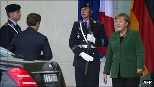 French President Nicolas Sarkozy arrives for talks with German Chancellor Angela Merkel