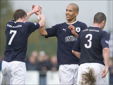 Farid El Alagui celebrates with his team-mates after scoring for Falkirk against Annan Athletic