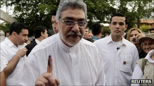 Paraguayan President Fernando Lugo displays his inked finger after voting in Asuncion