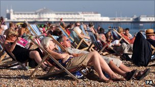 People enjoying last month&#039;s sunshine on the beach in Brighton