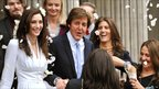 Sir Paul McCartney and Nancy Shevell emerge from the register office as man and wife