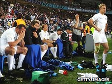 England's bench looks on as they lose to France in the Rugby World Cup quarter-final
