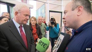 Martin McGuinness confronted by David Kelly, with a picture of his dad