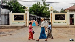 File image of people walking past Insein prison in Rangoon, Burma