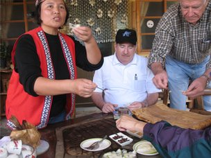 Alishan tribe member with tourists