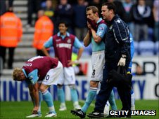 West Ham's Jonathan Spector (right) is consoled after the club's relegation from the Premier League