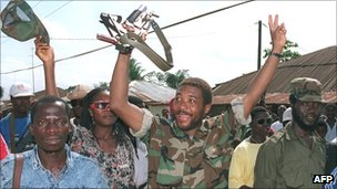Charles Taylor celebrates with his forces after a victory over government troops of President Samuel Doe in Monrovia in 1990