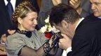Ukrainian President Viktor Yushchenko right, kisses the hands of newly appointed Prime Minister Yulia Tymoshenko in the Ukrainian parliament in Kiev, Feb 4, 2005