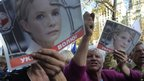 Tymoshenko supporters shouts slogans outside court in Kiev, Sept 27 2011