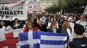 Greek Red Cross workers demonstrate in front of the Greek Parliament the Greek Parliament on October 11, 2011.