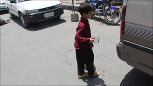 Girl disguised as boy selling water in Kabul