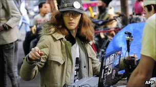 A woman runs an internet stream at Occupy Wall Street in New York