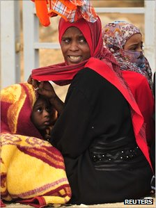 A woman displaced by the fighting in Sirte