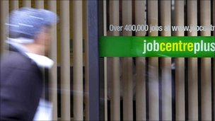 A person passing a Job Centre Plus