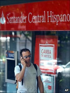 Man walking past Santander bank in Madrid