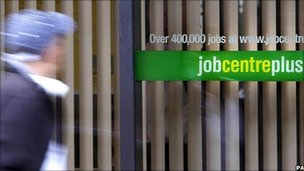 Man walking past job centre