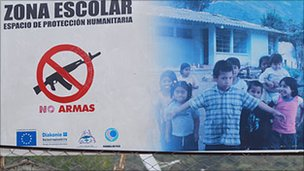 Sign identifying a school in Cauca