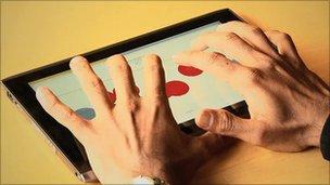 Mr Dharmaraja using iPad with Braille software