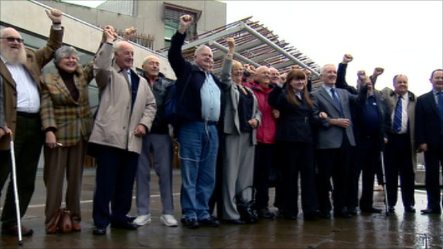 People celebrating outside the Scottish Parliament