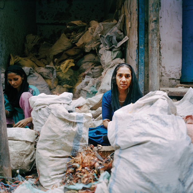 Women sorting copper, Seelampur, Delhi, India