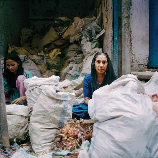 Women sorting copper, Seelampur, Delhi, India