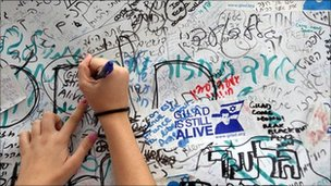 Writing on wall of Gilad Shalit's family protest tent