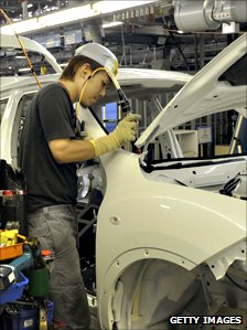 Nissan factory employee works on car