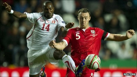 Darcy Blake challenges Innocent Emeghara of Switzerland during Wales' 2-0 Euro 2012 qualifying win
