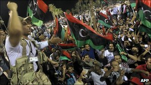 Anti-Gaddafi fighters in Tripoli celebrate reports that Mutassim Gaddafi has been captured - 12 October 2011