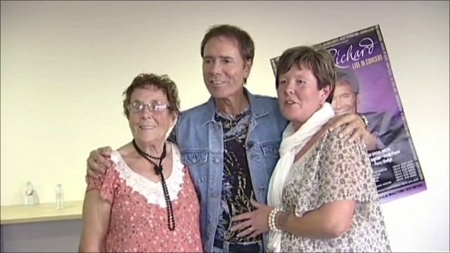 Cliff Richard poses with fans