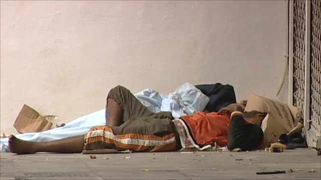 Two homeless people sleeping on an Athens street